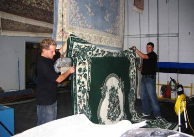 Men cleaning oriental rugs in Oakville